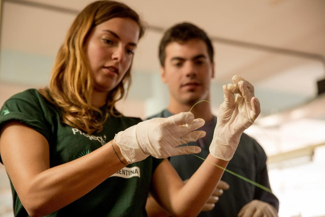 A pre med student learns to suture during a medical workshop on an internship in Argentina.